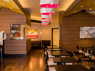 Journeys East Asian cuisine to dine in or take out at luxurious Tulalip Casino Resort near Seattle – dining room tables