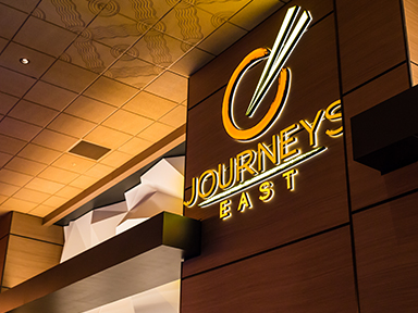 Journeys East Asian cuisine to dine in or take out at luxurious Tulalip Casino Resort near Seattle – logo in neon